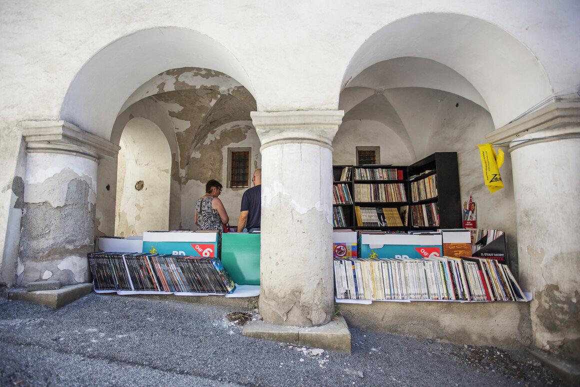 Books hide behind arches in St.-Pierre-de-Clages, Switzerland.