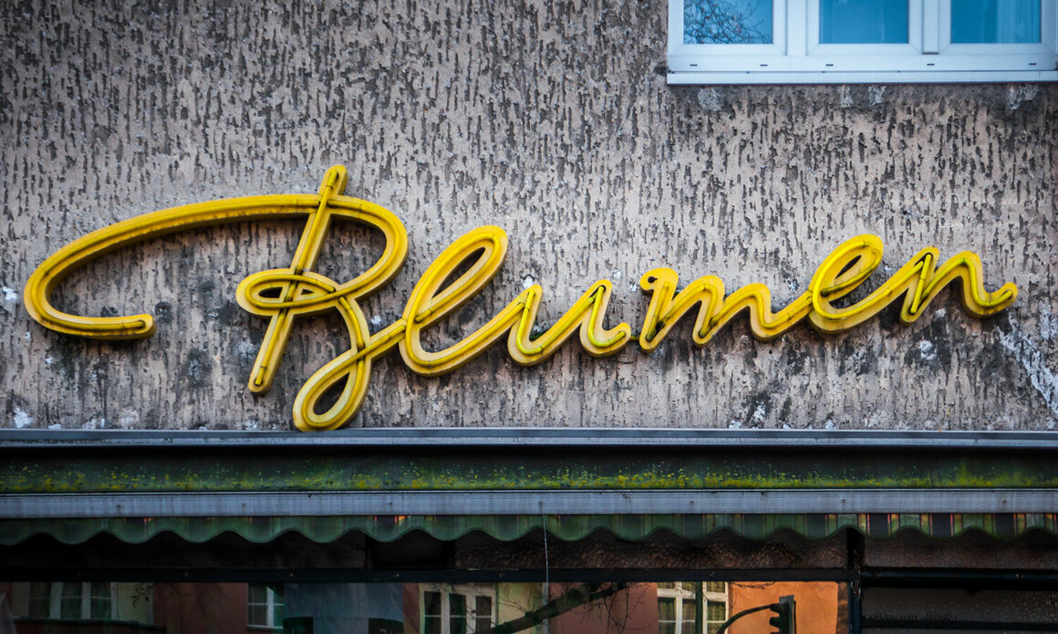 A cursive neon sign for a florist, with a particularly enchanting 'B.'