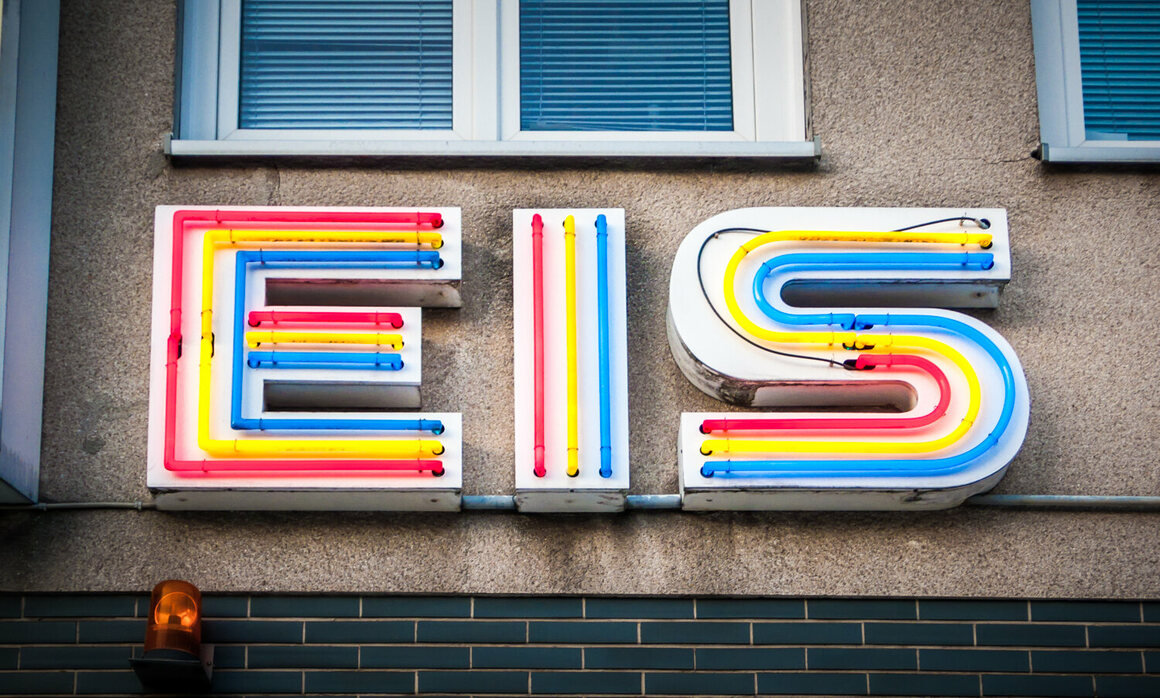 A brightly colored neon sign for an ice-cream store.