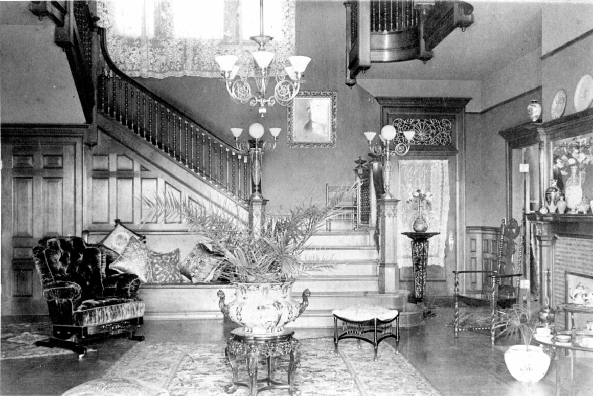 This interior shot shows the house as it was when it was originally built for the owner Cornelia Hill. After she sold the house to the Kimberly's in 1905 they remodeled this room, making the photo unique in that it shows the original architectural design of the interior, c. 1897-1905.