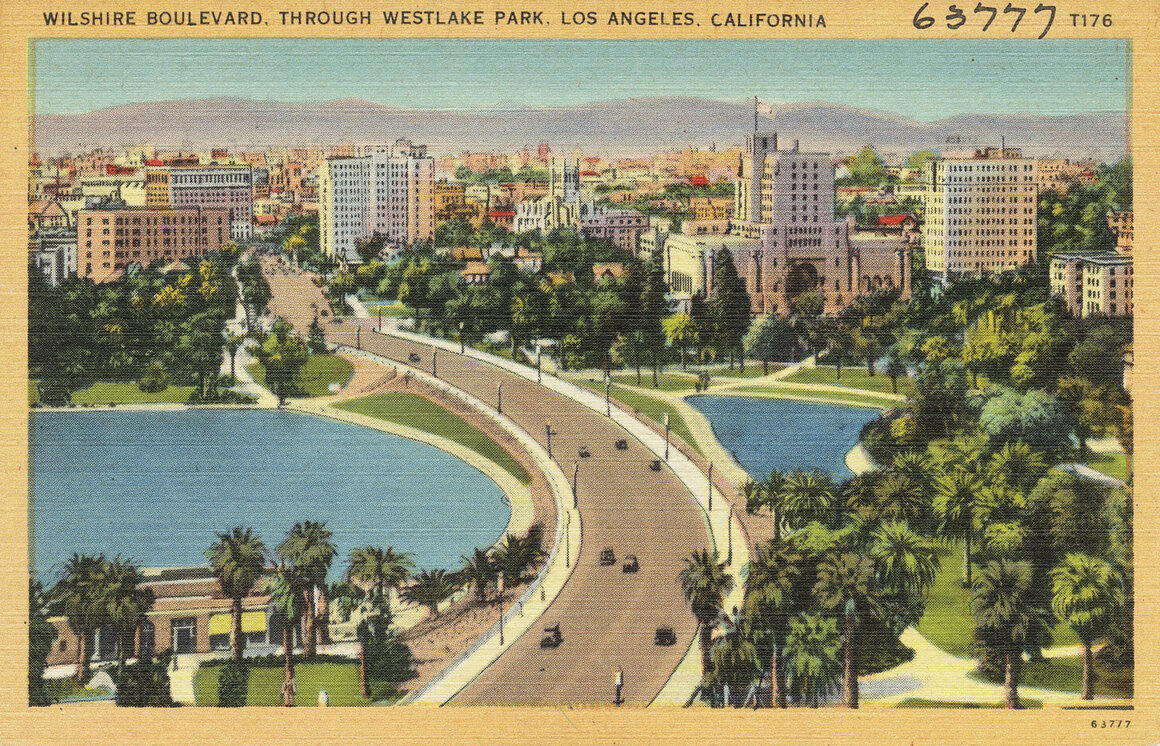 Los Angeles, lined with palm trees, on a postcard from the 1930s.