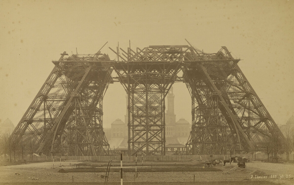 A photograph by Louis-Émile Durandelle of the construction of the Eiffel Tower, taken in January 1888. In this photo, the tower is reaching its first level; it was completed on March 31, 1889.