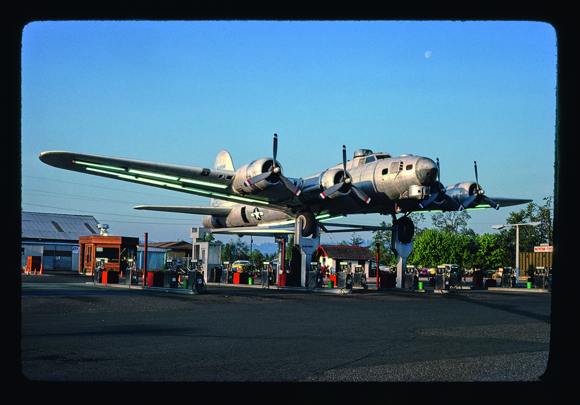 A WWII Boeing B-17 Flying Fortress bomber repurposed as a gas station canopy in Milwaukie, Oregon. The airplane has since been relocated for restoration.