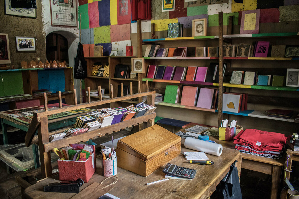 The workshop's small gift shop is filled floor-to-ceiling with handmade books, posters, and notebooks.