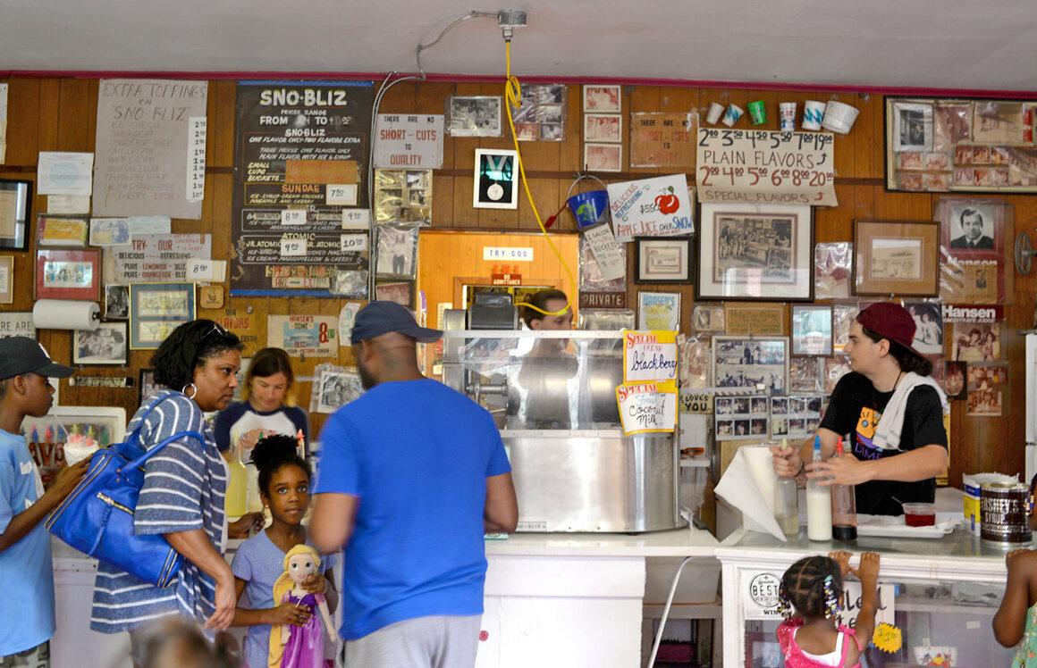 Inside Hansen's Sno-Bliz, decades of neighborhood history cover the walls.