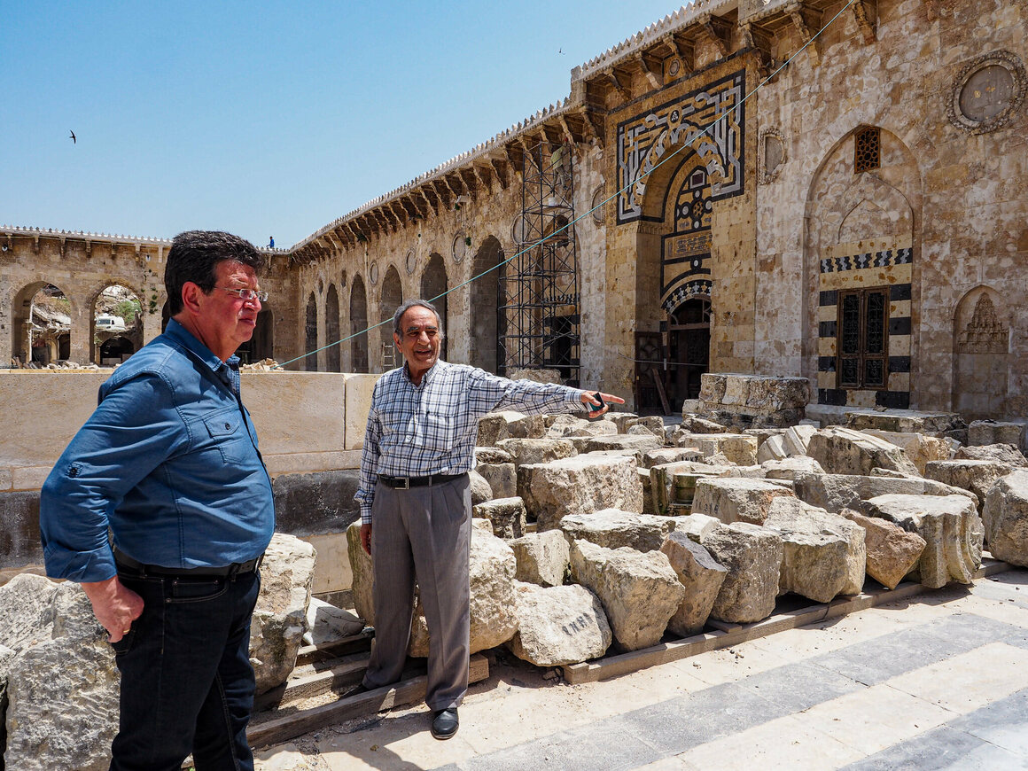 Architect Sakher Oulabi (left) and engineer Tamim Kasmo in the courtyard of Aleppo's Great Mosque.