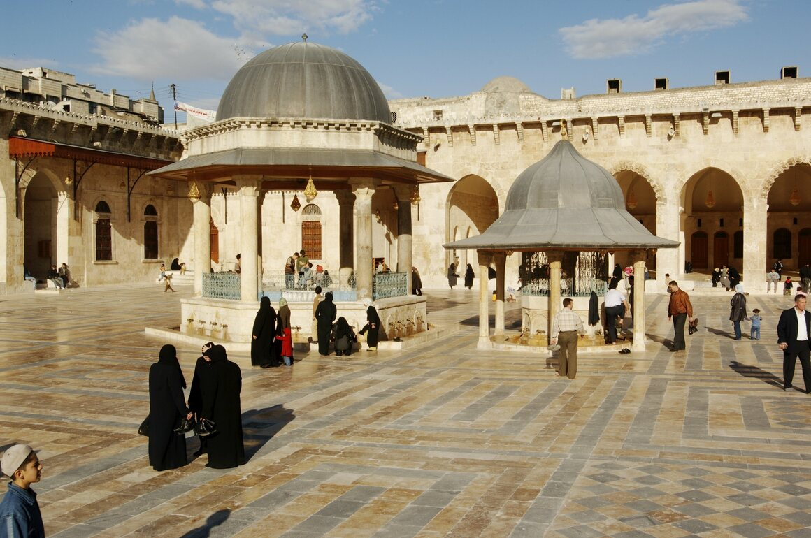 This historical image shows the courtyard of Aleppo's Great Mosque, which covers almost an acre in the heart of the Old Quarter.
