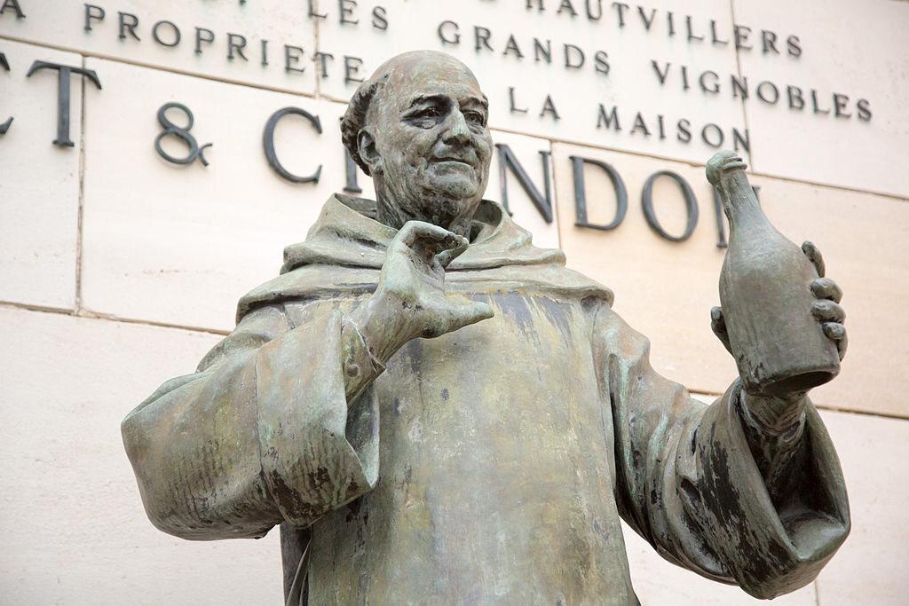 A statue on the Avenue de Champagne lauds Dom Pérignon (and the humble bottle.)