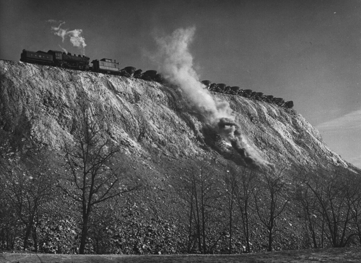 Railroad cars release hot slag onto Brown's Dump, located southeast of Pittsburgh, Pennsylvania.
