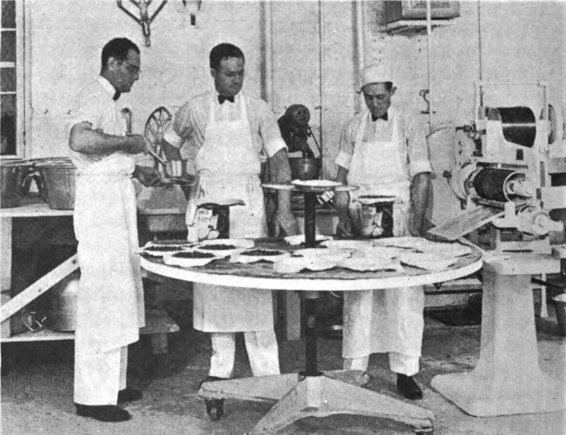 Here, Strause teaches his pie-making methods to two students.