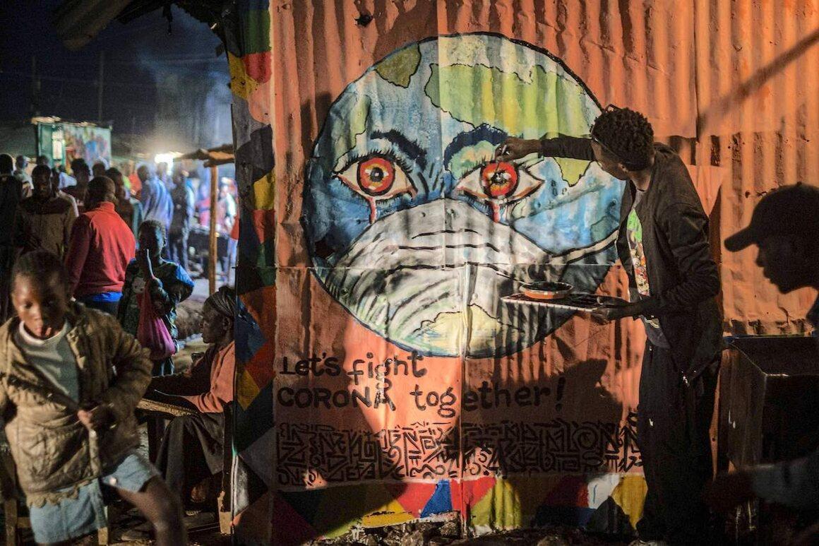 Visual artist Grandsan paints graffiti at a butcher shop in Kibera, Kenya, March 23, 2020.