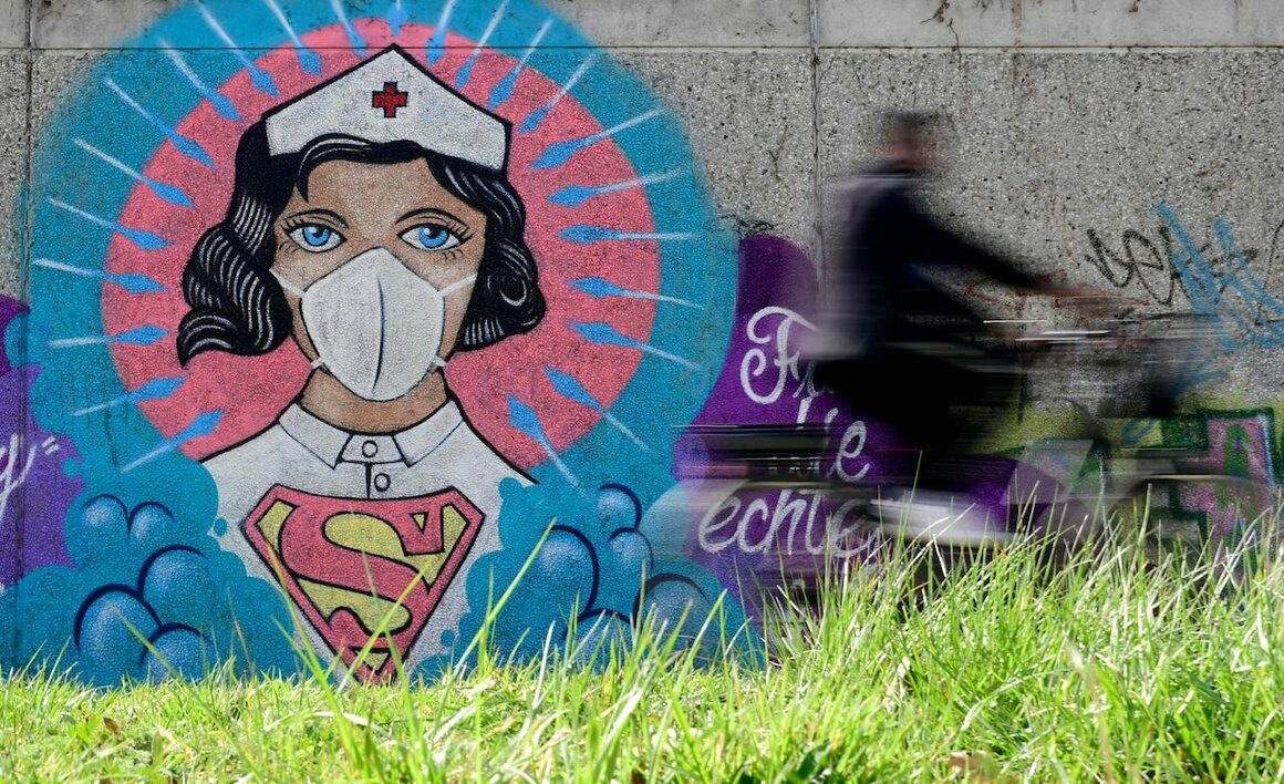 Artist Kai 'Uzey' Wohlgemuth depicted a nurse as Superwoman in Hamm, Germany, April 8, 2020.