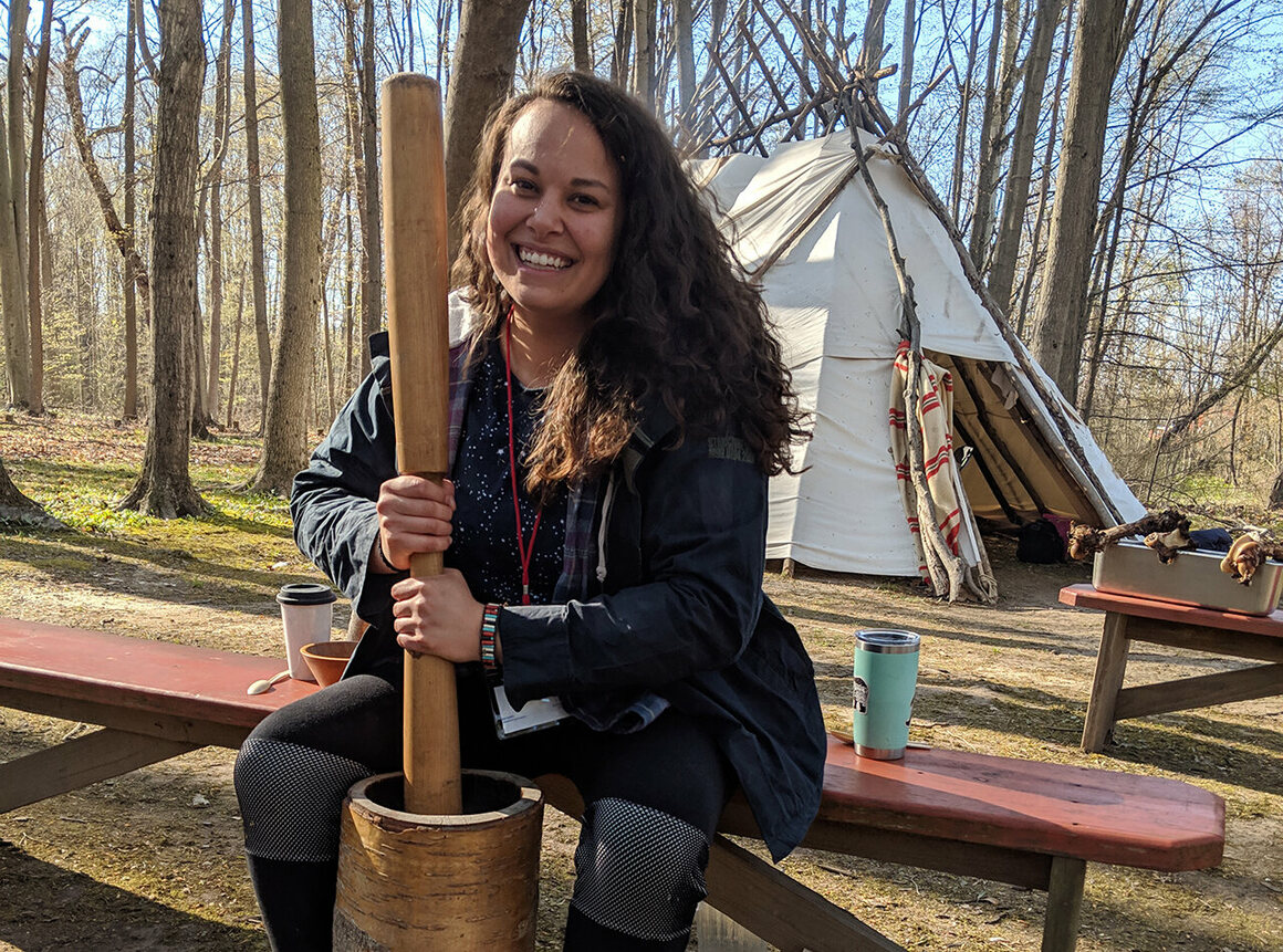 Taelor Barton at the 2019 Intertribal Food Summit preparing hickory nuts for kanuchi, a traditional Southeastern dish her grandmother taught her.