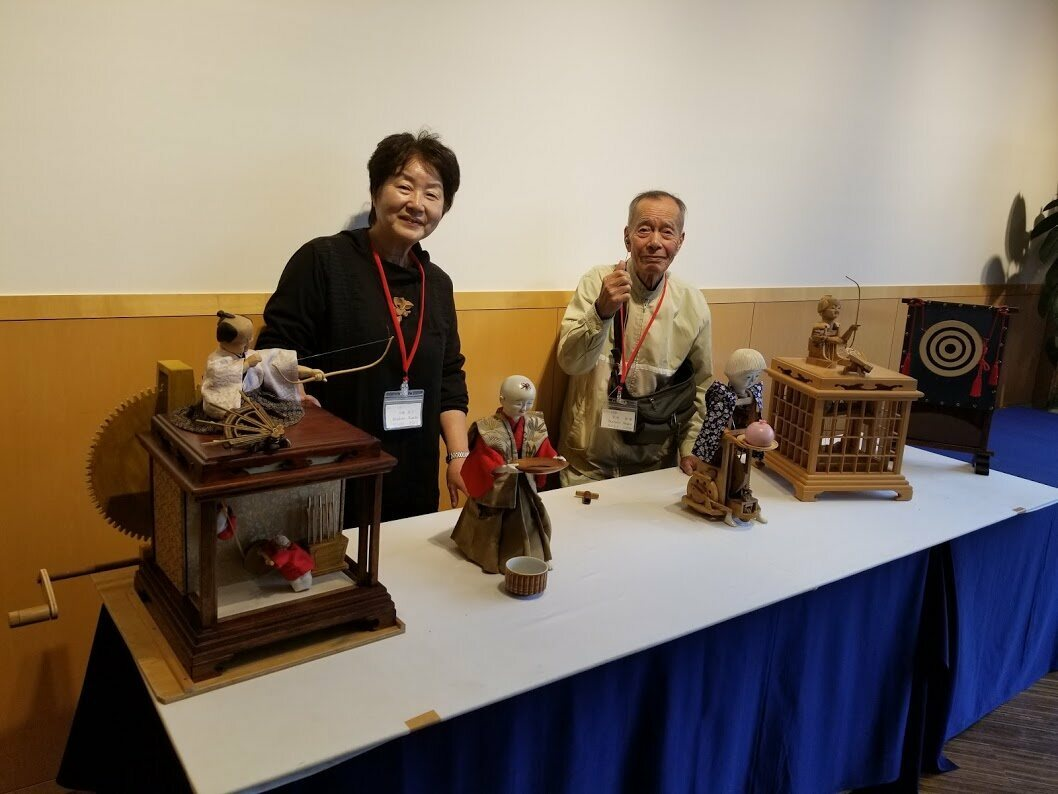 Kimiko Hirahata (left) and Shigeo Tanimoto with their wooden automatons—the culmination of years of work.