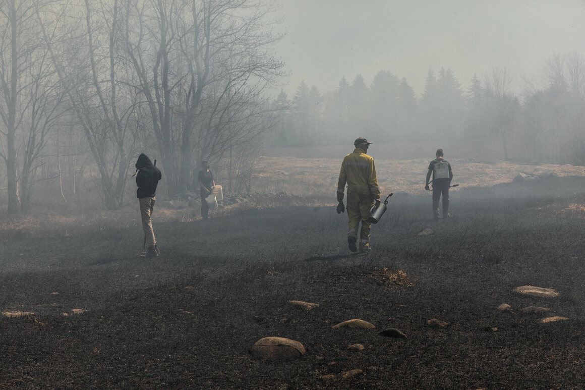 Nicolas Lindholm and his crew walks through the burnt area.