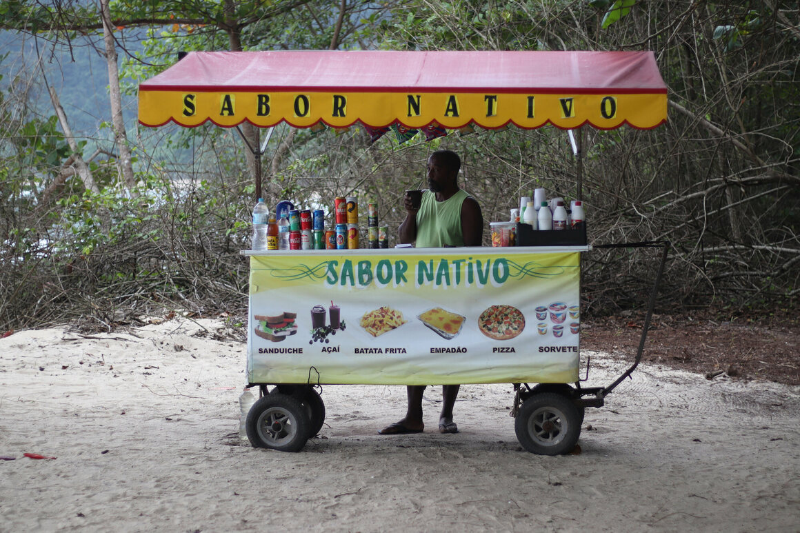 Moises, a street vendor, makes a living selling food and drinks to tourists.