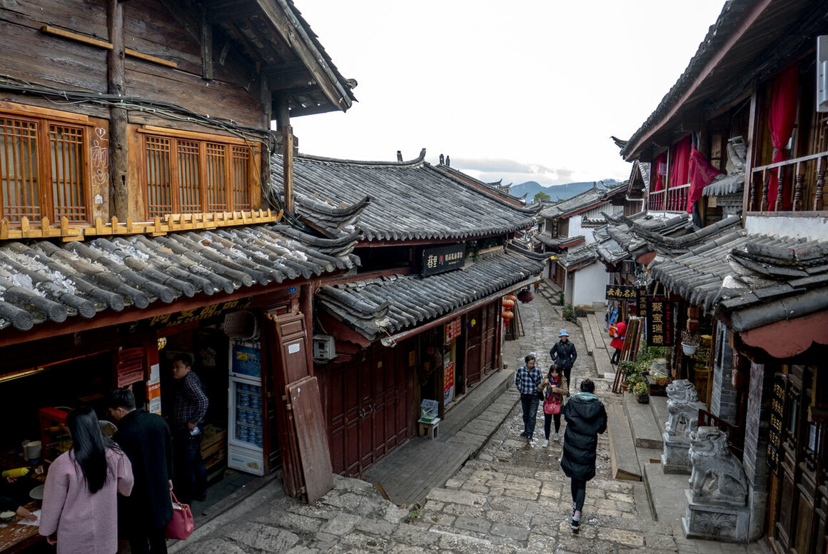 Now that Lijiang has become a tourist hub, specialty shops line the ancient cobblestone streets.