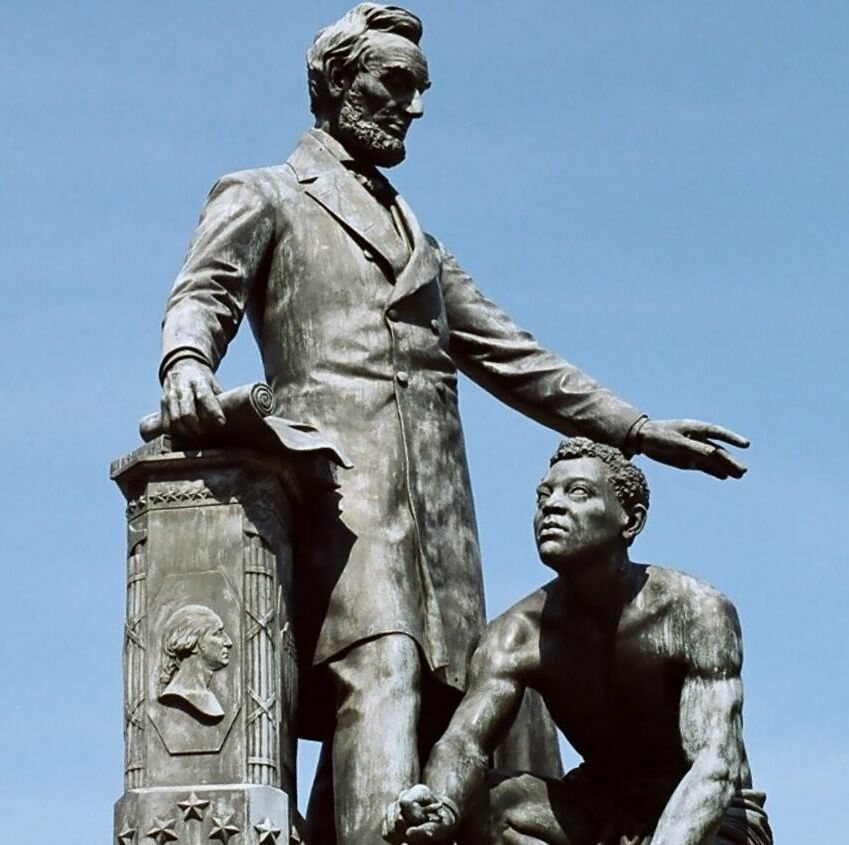The Emancipation Memorial in Washington, D.C., depicts Abraham Lincoln standing over an emancipated Black man, modeled on Archer Alexander.