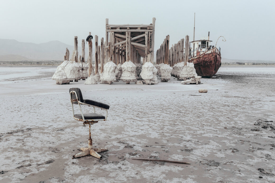 At the port of Sharafkhaneh in 2015, an abandoned ship is stuck in solidified salt.