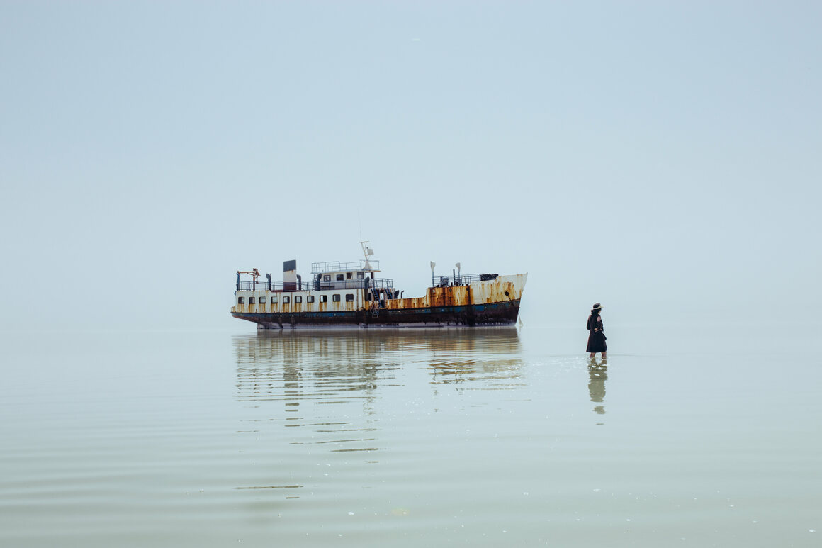 The ship <em>Hamzeh</em>, seen here in 2016, used to ferry passengers across the lake. It ran aground due to devastating water loss in what was once the sixth-largest salt lake on the planet.