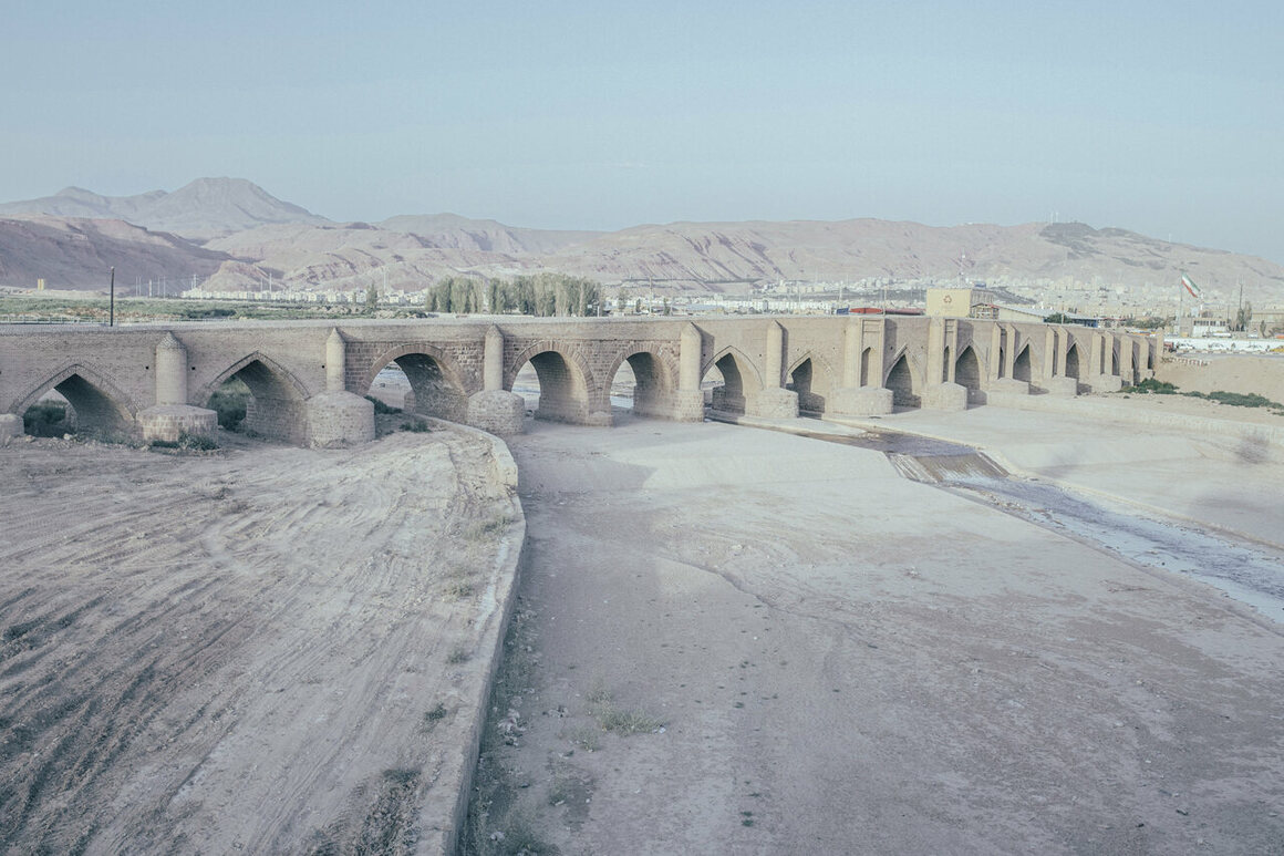 Aji Chay, a river that is barely visible in this 2019 photograph, passes underneath a historic bridge in Tabriz, Iran, and flows into Lake Urmia. Droughts have slowed its flow to a trickle.