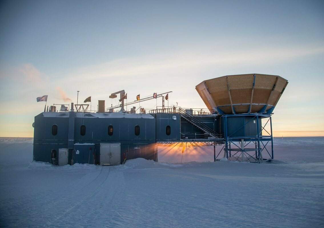 The sun sets behind the Martin A. Pomerantz Observatory at the South Pole in 2019.