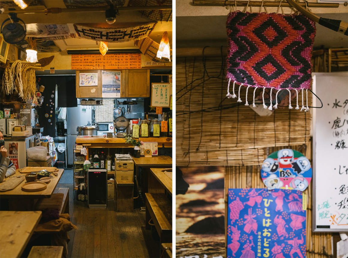 Harukor has only five tables and the kitchen is at the far end of the restaurant. The fabric on the right features an Ainu pattern, and the poster is of an Ainu dance performance.