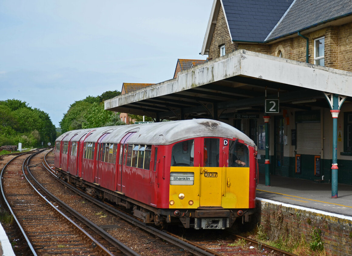 A former London Underground train approaches Sandown station on the Isle of Wight.