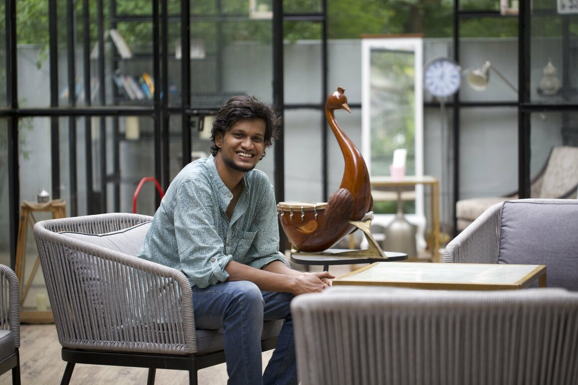 Tharun Sekar, with one of the yazh he crafted from a single block of wood, wants to bring back lost musical instruments.