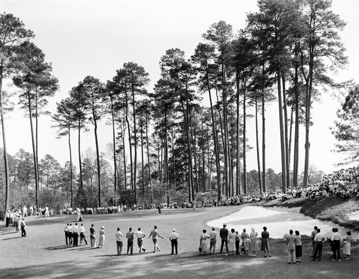 A crowd gathers at the 1950 Masters Tournament at Augusta National Golf Club.