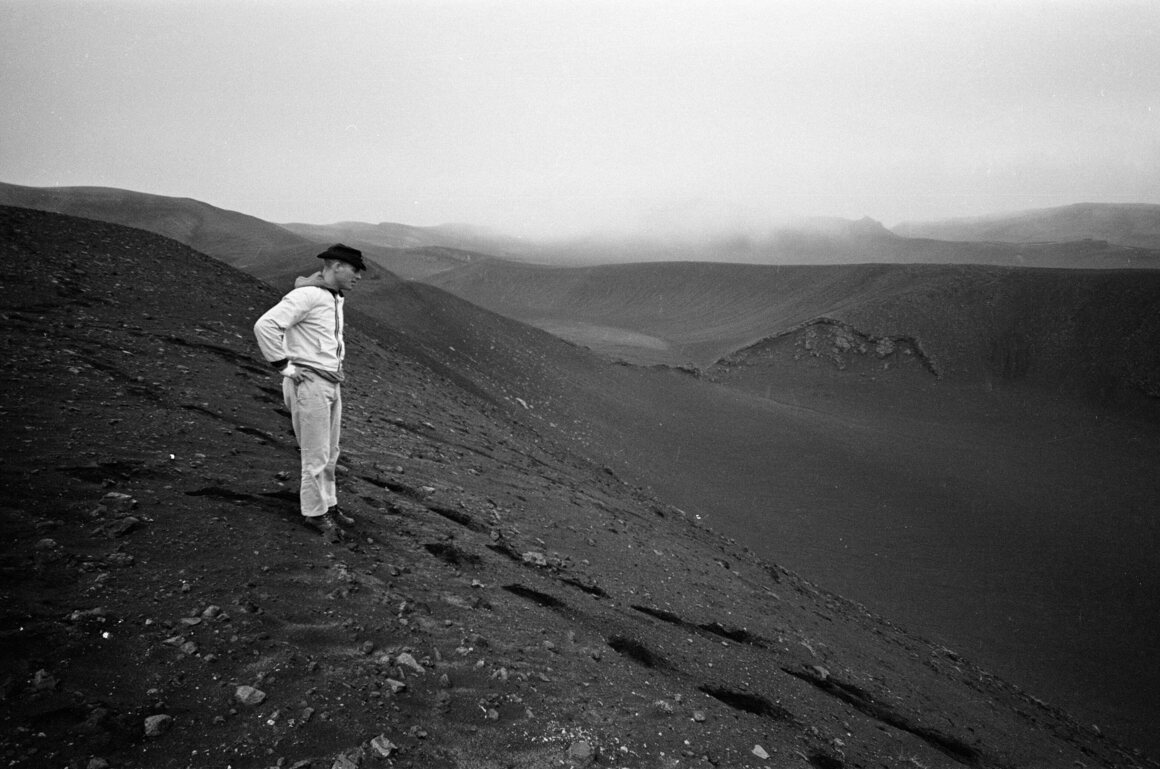 An unnamed American astronaut looks out over the Laugahraun lava field in 1967.