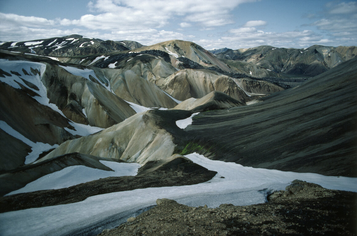 Iceland's volcanic interior, including the Landmannalaugar Mountains, are known for their desolate scenery.
