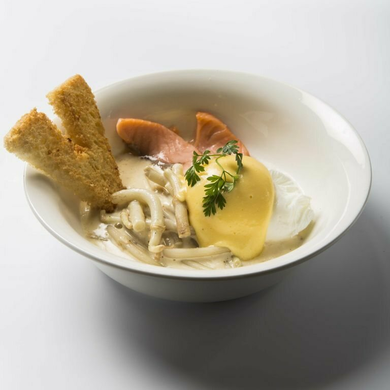 This Belgian preparation pairs hops shoots with poached eggs and salmon in creamy sauce.