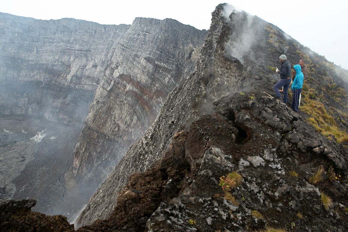 A team from the Goma Volcano Observatory looks down into the crater on Nyiragongo in February 2021.