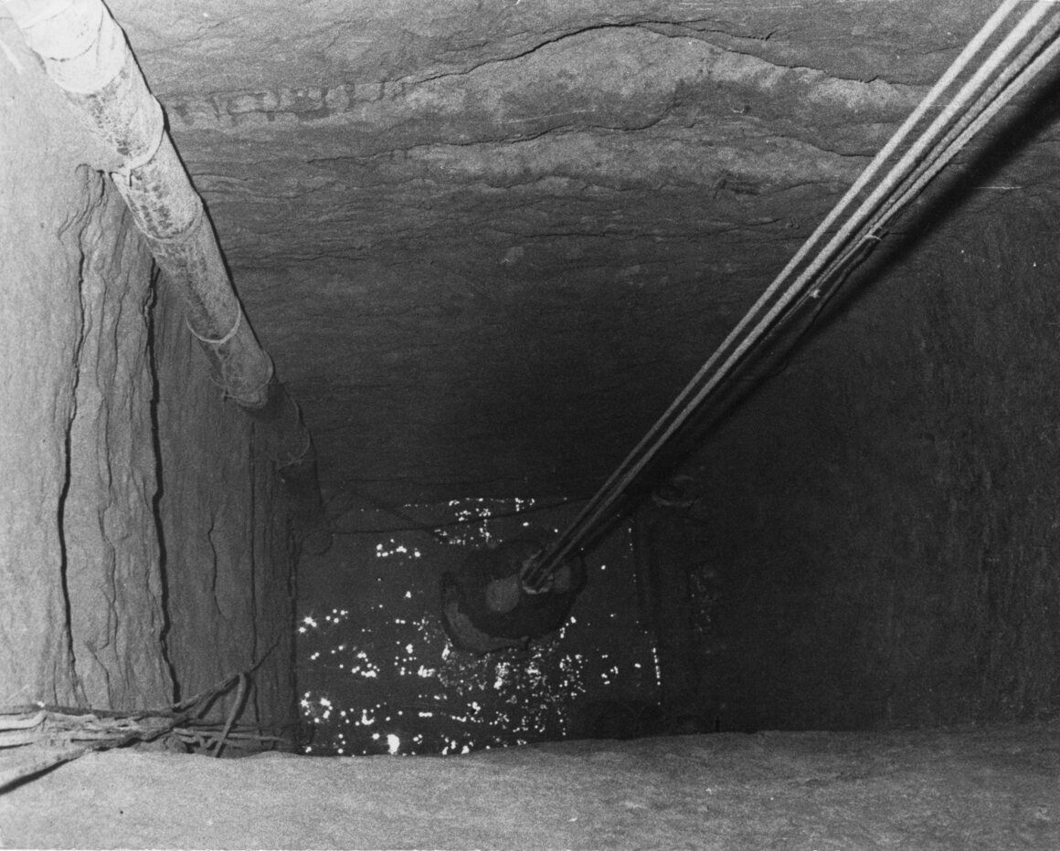 A refugee from East Germany is winched up to the exit of Tunnel 57 and into a disused bakery in West Berlin.