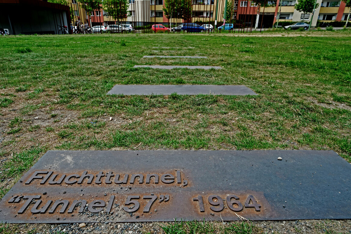 A plaque marks the route of Tunnel 57 below the Berlin Wall.