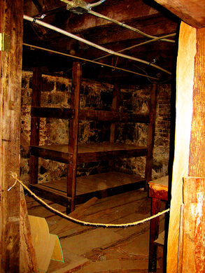 Underground opium den with several bunks. Copyright Michael P. Jones/Cascade Geographic Society 2010.
