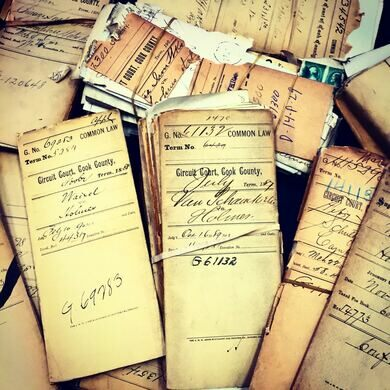 Stacks of Holmes Paperwork tour guide Adam Selzer has pored over in the archives.