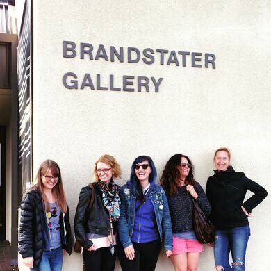 Curator Torrey Cook and artists in front of Brandstater Art Gallery