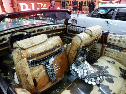 1975 Cadillac encrusted with 500 silver dollars and six-shooter door handles