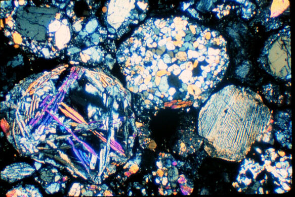 Three complete chondrules. These millimeter-sized objects formed during brief melting events in the Solar Nebula.
