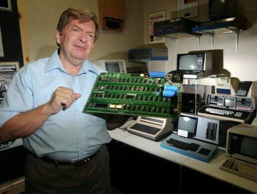 George Keremedjiev holds an Apple I computer, built by the company's co-founders Steve Wozniak and Steve Jobs. Photo by James Woodcock.