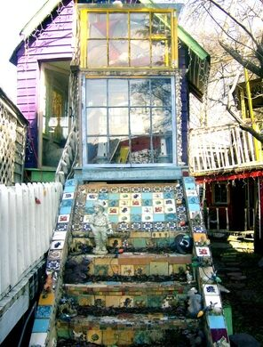 The exterior of one of the doll houses. Visible are the raised walkways that connect some of the houses.