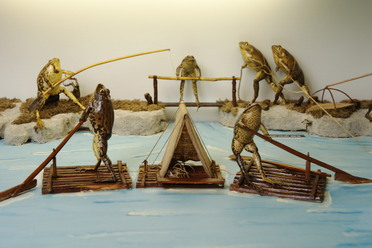Taxidermied frogs spend a day on the lake at Froggyland
