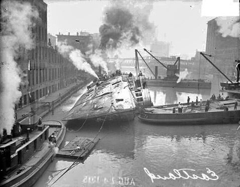 The steamer Eastland being righted after capsizing in the Chicago River near the Loop community. Chicago Daily News, Inc., photographer