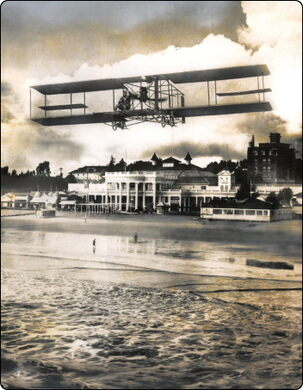 1911, LGB founder Earl Daugherty over the coast