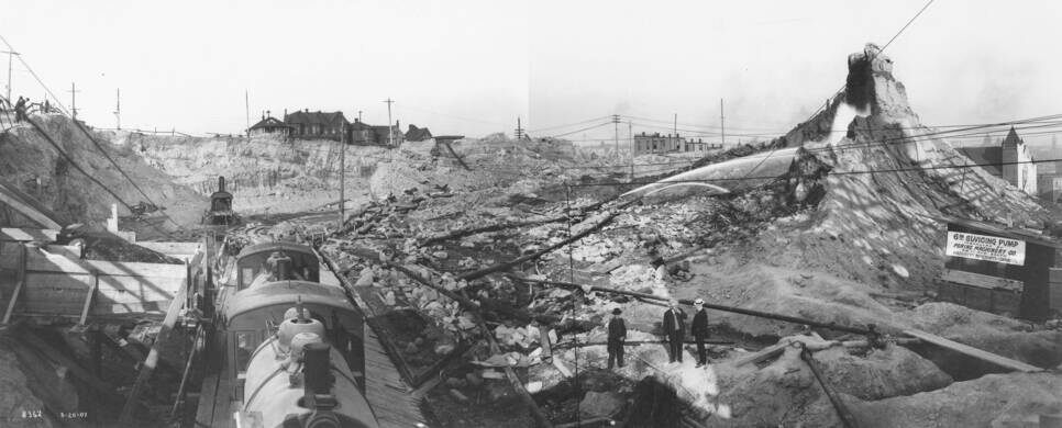 Denny Regrade in the vicinity of 2nd Ave. and Virginia St. showing the use of hydraulic giants, Seattle, August 20, 1907