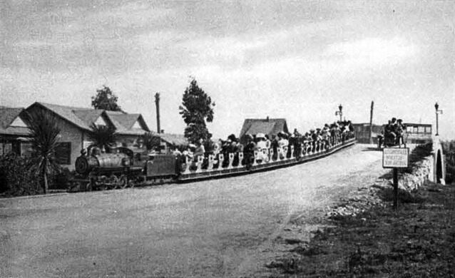 Venice Miniature Railway train crossing over a Venice Canal bridge