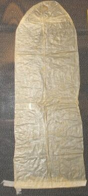 Light tan, sheepskin condom with rounded tip and white ribbon string at base. Item has been folded and retains the fold lines. Sold by Mr. Isaac De Young, in Philadelphia, PA.