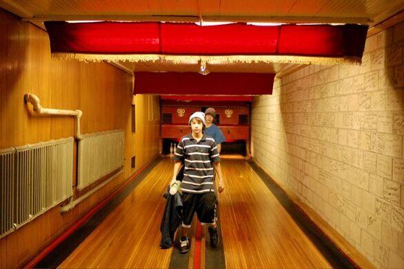Original wooden bowling lanes and pin boys